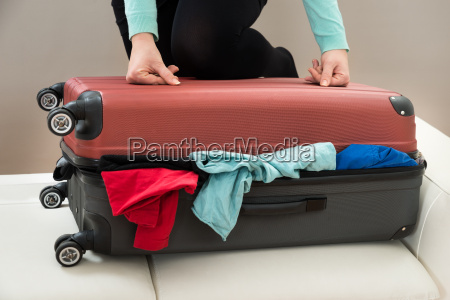 close up of woman with suitcase
