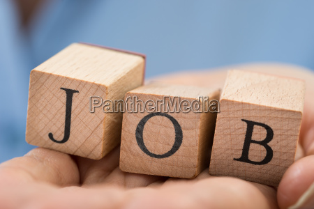 person hand mit dem wort job