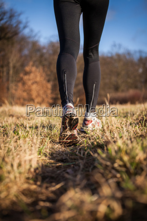jogging outdoors in a meadow shallow