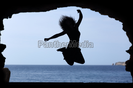 silhouette of a woman jumping on