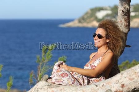tourist woman relaxing on the beach