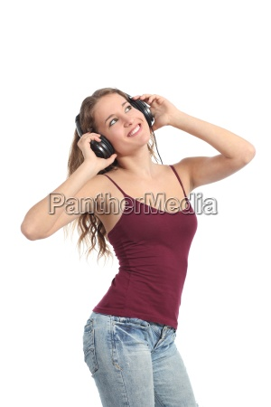 pretty teenager girl dancing and listening