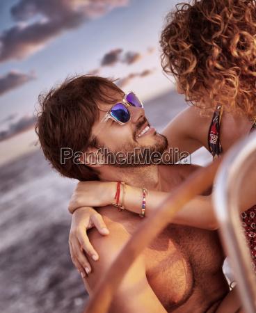 happy loving couple on sailboat