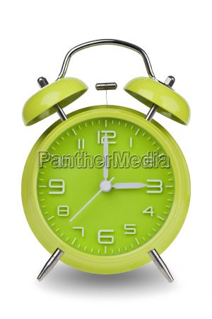 green alarm clock with hands at