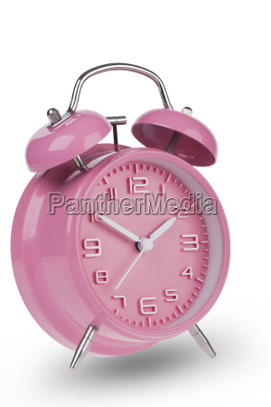 pink alarm clock with the hands