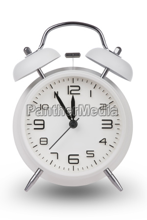white alarm clock with hands at