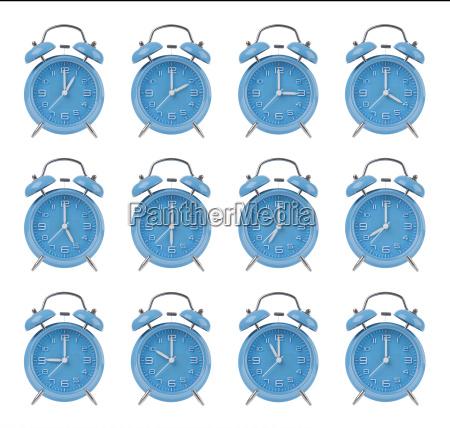 twelve alarm clocks at the top