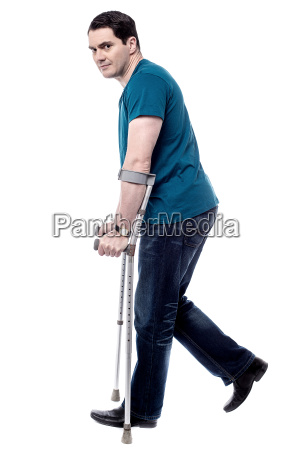 injured man with crutches