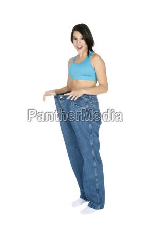 beautiful caucasian woman showing weight loss