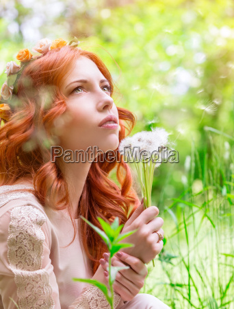 dreamy woman with dandelions