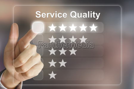 business hand pushing service quality on
