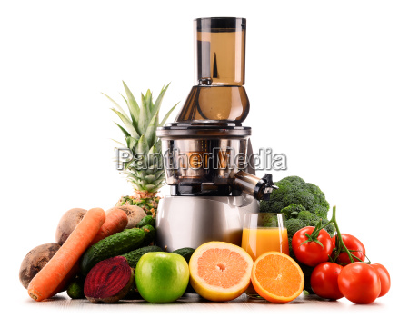 slow juicer with organic fruits and