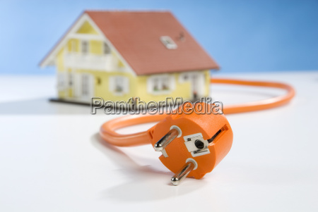 house with cable and plug