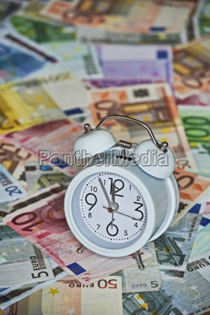time is money with clock and