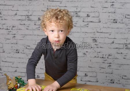 a little boy plays on a