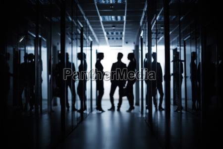 business meeting in corridor