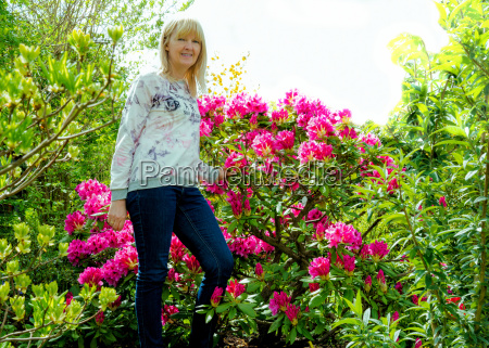 woman with beautiful rhododendron