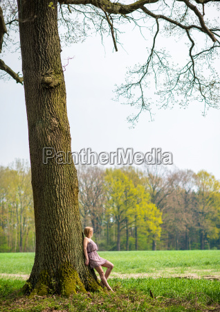 young woman in summer dress leaning
