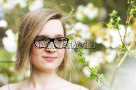 young woman with glasses in the