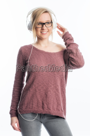 young woman with glasses wearing headphones
