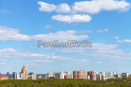blue spring sky over city and