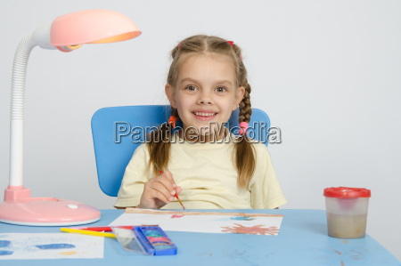 six year old girl smiling happily