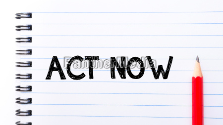 act now text written on notebook