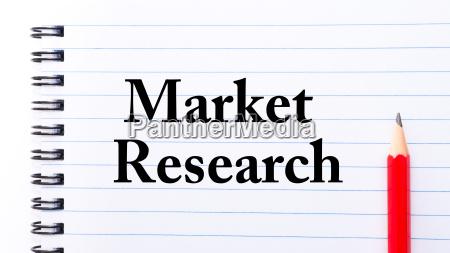 market research text written on notebook