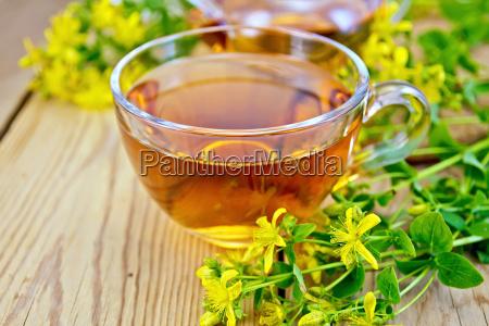 tea from tutsan in glass cup