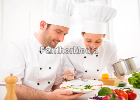young attractives professionals chefs cooking together