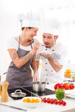 young chef training a young attractive