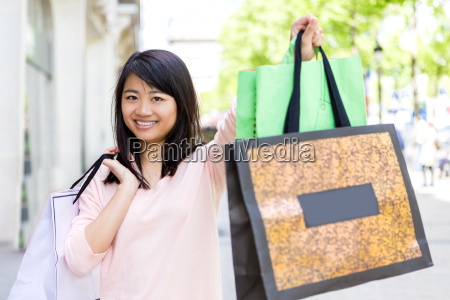 young attractive asian tourist doing shopping