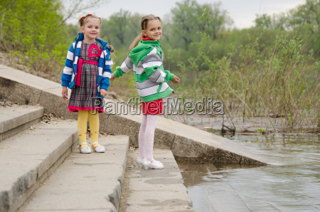two girls standing on the steps