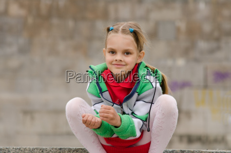 six year old girl crouched on
