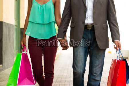 african american couple shopping with bags