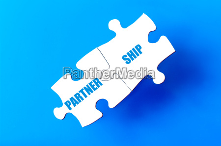 connected puzzle pieces with word partnership