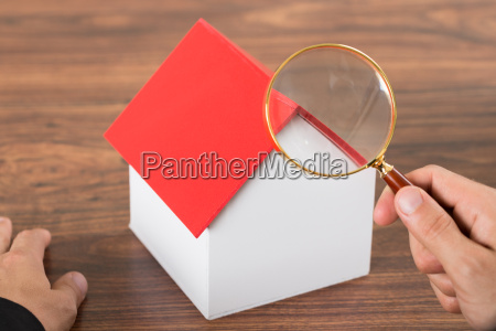 person hands with magnifying glass and