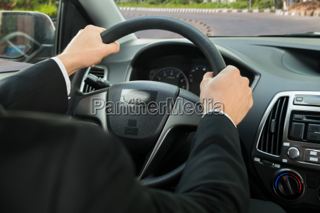 close up of a drivers hand