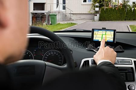 businessman using gps navigation system in