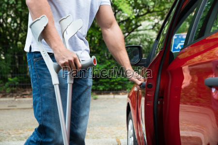 disabled man opening door of a
