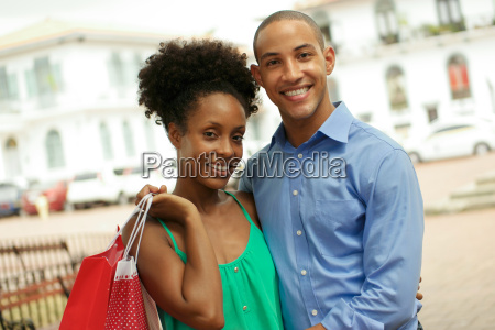 portrait african american couple shopping in