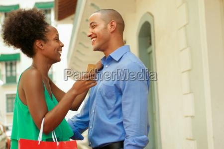 african american couple holding credit card