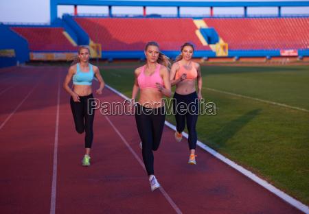 athlete woman group running on