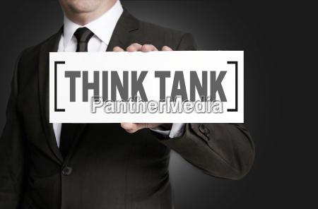 think tank schild wird von geschaeftsmann
