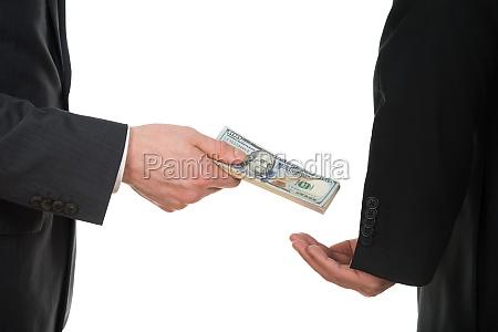 businessman taking bribe