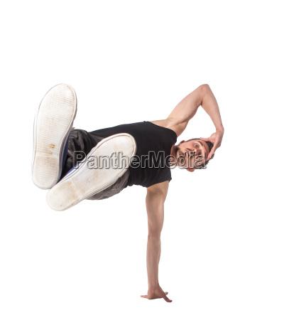 breakdancer macht einhaendige handstand vor einem