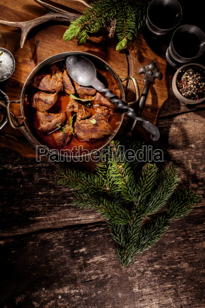 venison goulash stew in pot with