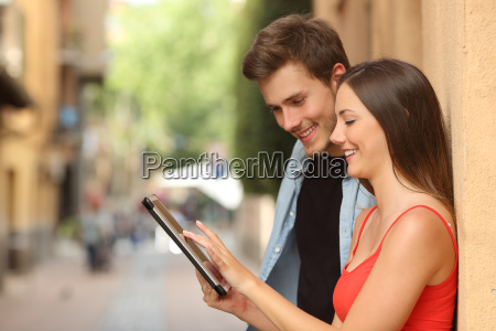 couple browsing a tablet in the