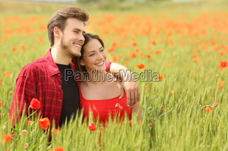 couple hugging and walking in a
