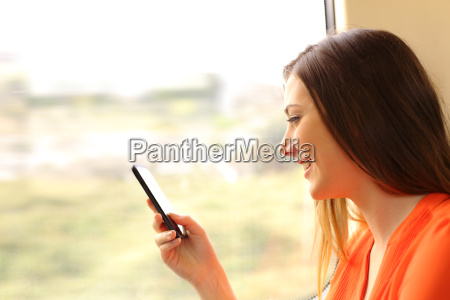 passenger using a mobile phone in